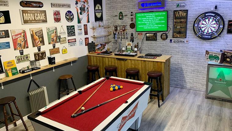 man cave bar fridge and pool table